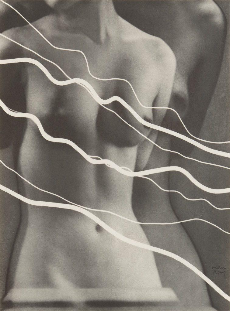 Man Ray: Electricité, 1931 rayografia: ritratto di donna nuda